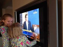 Senator Ted Cruz's daughters watch their dad speak on the Senate floor.