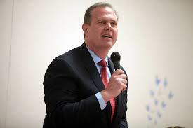 Debate moderator and former candidate for U.S. Senate, Alex Meluskey